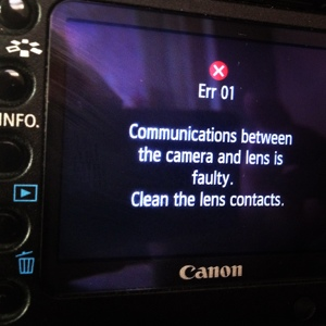 Err 01 Communications between the camera and lens is faulty